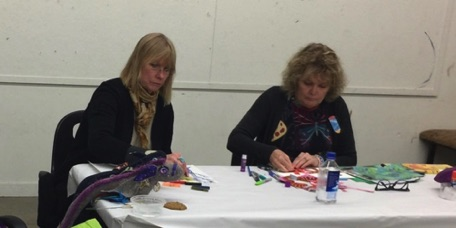 Verletta Russell and Susie Games concentrate of art making