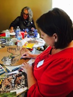 Ashley Hunt and Mary Jo Weatherly concentrate on their art work
